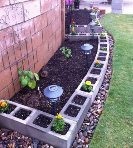 vegetable and flower bed cinder block edging- DIYscoop.com